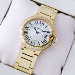 Ballon Bleu de Cartier quartz suisse montres avec diamants en or jaune 18 kt